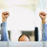 Office worker with raised fists
